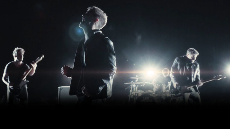 last one alive kiss the ground music video band members performing
