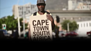 street store campaign video homeless man holding sign in cape town